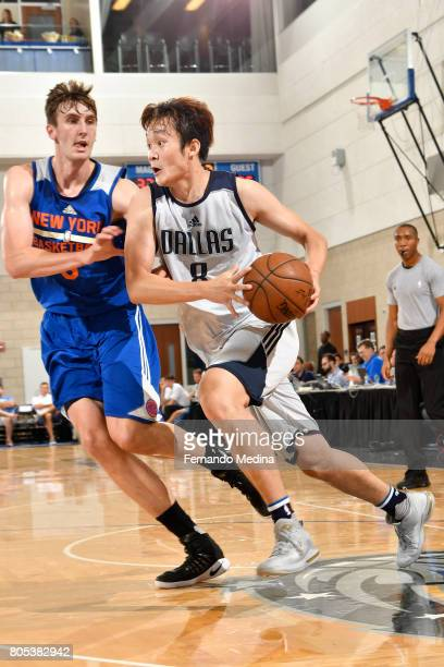 Ding Yanyuhang of the Dallas Mavericks handles the ball against the New York Knicks during the 2017 Summer League on July 1 2017 at Amway Center in...