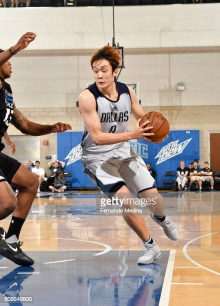 Ding Yanyuhang of the Dallas Mavericks handles the ball against the Orlando Magic on July 3 2017 during the 2017 Summer League at Amway Center in...