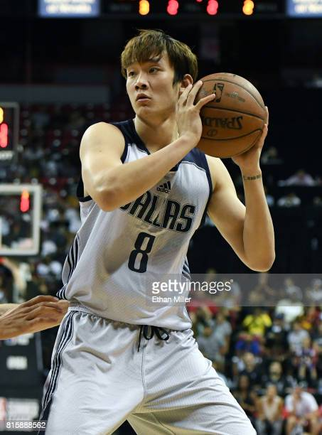 Ding Yanyuhang of the Dallas Mavericks holds the ball during a semifinal game of the 2017 Summer League against the Los Angeles Lakers at the Thomas...