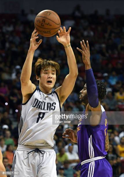 Ding Yanyuhang of the Dallas Mavericks passes the ball under pressure from Vander Blue of the Los Angeles Lakers during a semifinal game of the 2017...