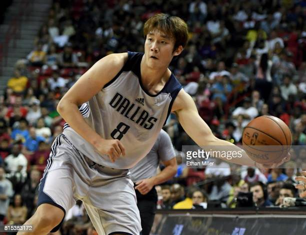 Ding Yanyuhang of the Dallas Mavericks saves the ball from going out of bounds during a 2017 Summer League game against the Boston Celtics at the...