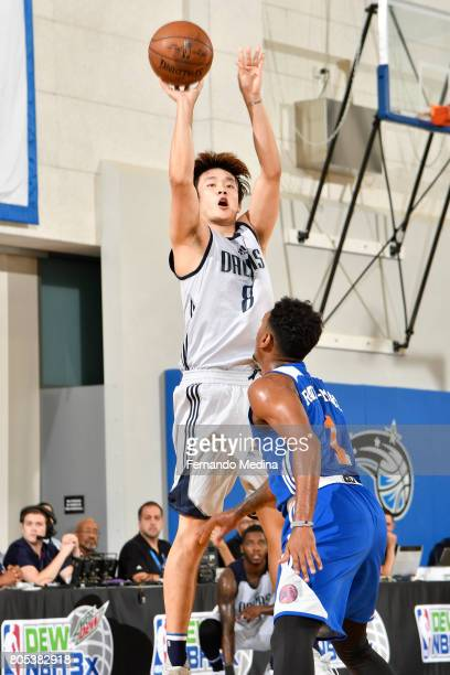 Ding Yanyuhang of the Dallas Mavericks shoots the ball against the New York Knicks during the 2017 Summer League on July 1 2017 at Amway Center in...