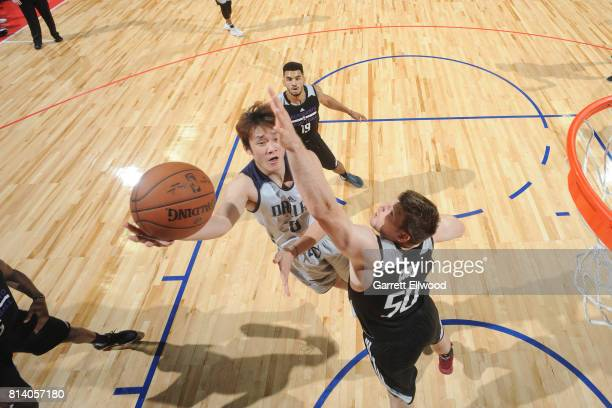 Ding Yanyuhang of the Dallas Mavericks shoots the ball against the Sacramento Kings on July 13 2017 at the Thomas Mack Center in Las Vegas Nevada...