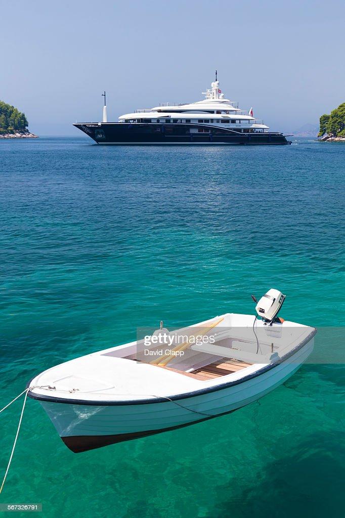 Dinghy and super cruiser, Cavtat, Croatia : Foto stock