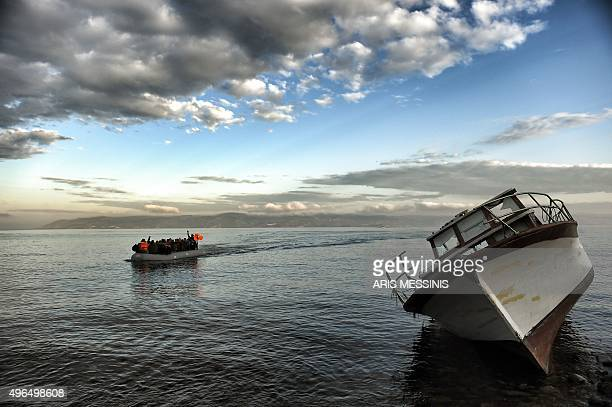 A dinghy carrying refugees and migrants crosses the Aegean Sea from Turkey to the Greek island of Lesbos on November 10 2015 Lesbos and other Greek...