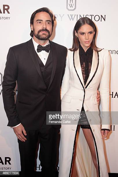 Dinho Diniz and Danielle Pontes attend the 5th Annual amfAR Inspiration Gala at the home of Dinho Diniz on April 10 2015 in Sao Paulo Brazil