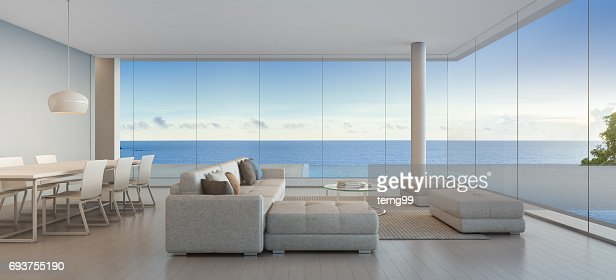 Dining and living room of luxury beach house with sea view swimming pool in modern design, Vacation home for big family : Stock Photo