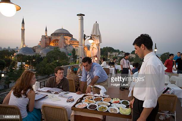 Dining at Seven Hills Roof Cafe & Restaurant in Sultanhamet, with Aya Sofya in background.