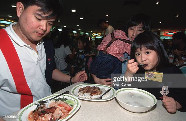 Dining out is cheap and fun at the Seacon square mall's hawker center Thai businessman Khun Pradith Sirijindaphan and family shake off crisis blues
