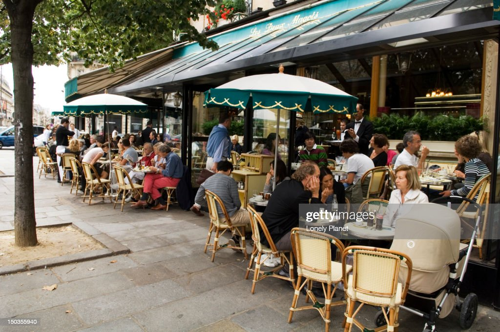 Dining outside Les Deux Magots in the St-Germain area. : Stock Photo