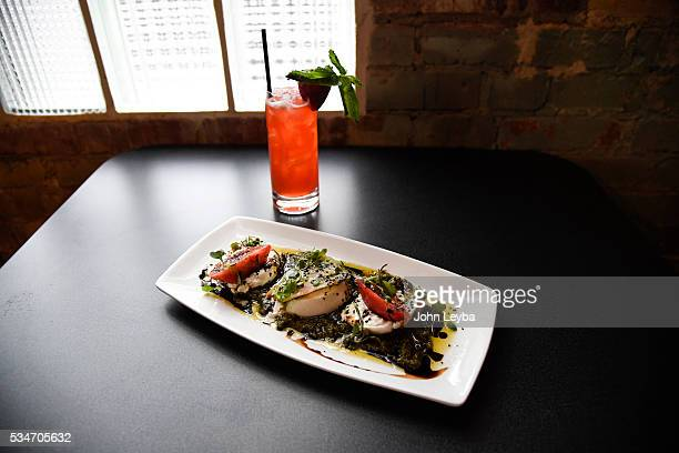 Dining review of Chow Urban Grill May 26 2016 including the tomato burrata with a Urban Strawberry drink Also in the review a Spanish octopus with...