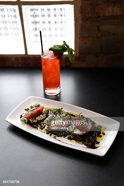 Dining review of Chow Urban Grill May 26 2016 including the tomato burrata with an Urban Strawberry drink Also in the review a Spanish octopus with...