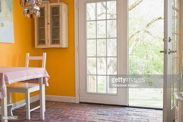 Dining table and open door