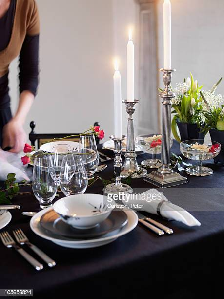 Dining table arrangement by woman