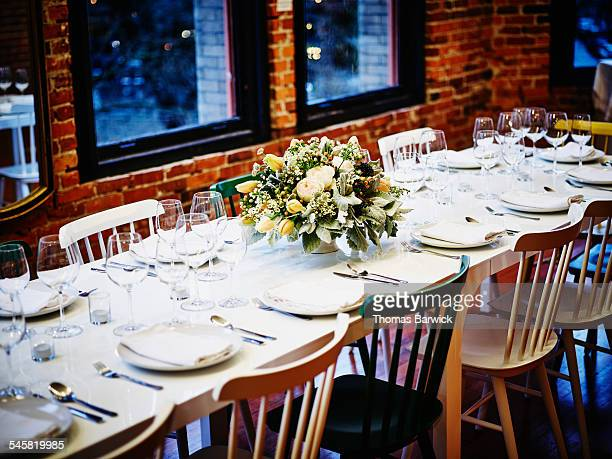 Dining table in loft set for formal dinner party