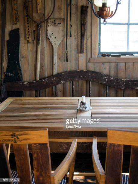 SJöBOD GREBBESTAD BOHUSLäN SWEDEN A dining table inside Everts Sjöbods a 19th century boathouse in Grebbestad West Sweden which is used to run a...