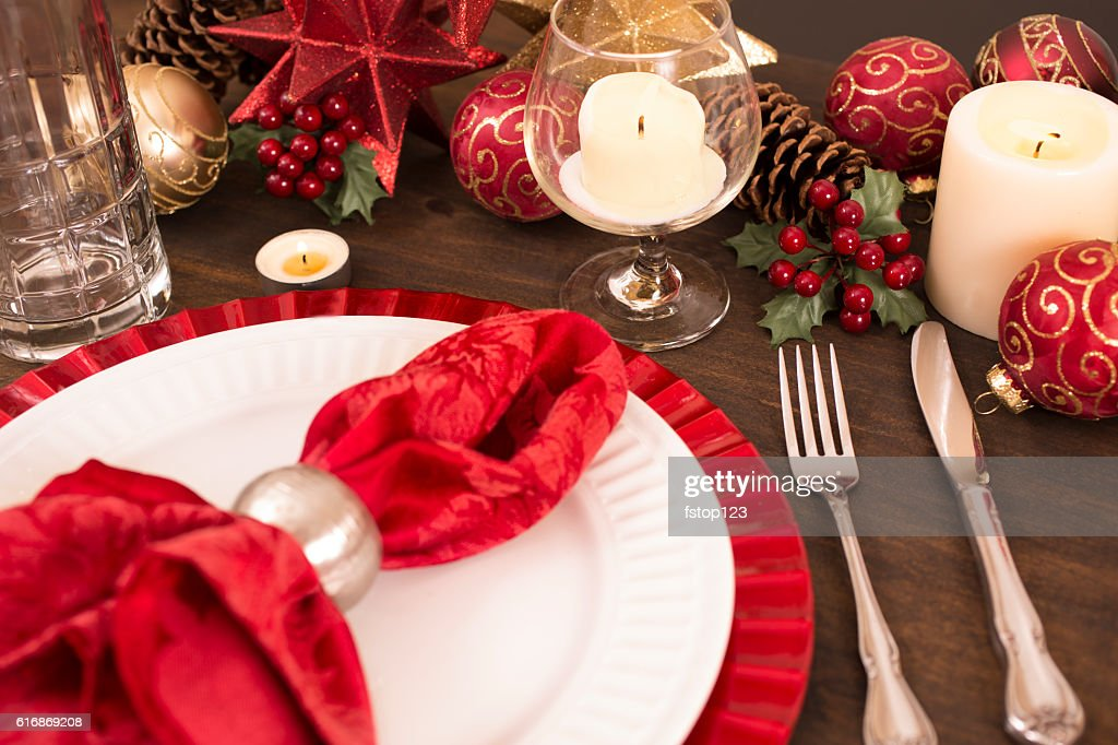 Dining table place setting with Merry Christmas holiday decorations. : Stock Photo