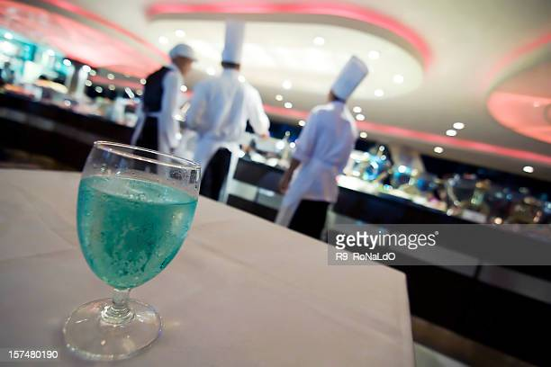 Dining table with cyan soda water in luxury restaurant