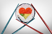 Dinner for two dining and romantic date concept as a couple of chopsticks holding a sushi piece with a love heart shape with 3D illustration elements.