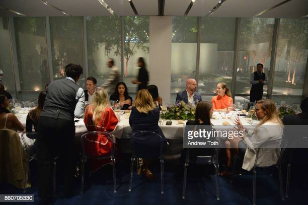 Dinner guests attend as Harper's BAZAAR and THE OUTNETCOM Celebrate the opening of MoMA's Fashion Exhibit 'Is Fashion Modern' at MOMA on October 12...