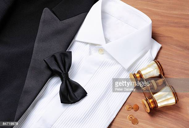 Dinner jacket, shirt, black tie with opera glasses