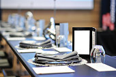 Dinner menu on round table meeting with full course dinner setting