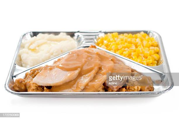 A TV dinner of turkey, sweet corn and mashed potatoes