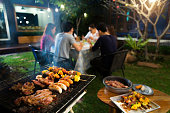 Dinner party, barbecue and roast pork at night