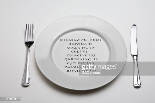 Dinner plate with calorific value of exercise : Stock Photo