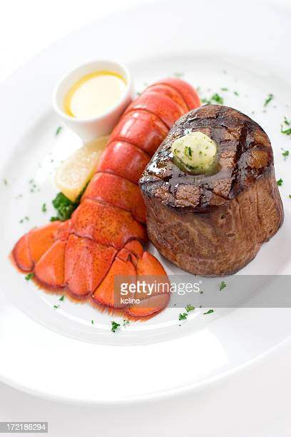 Dinner plate with filet mignon and lobster tail with butter
