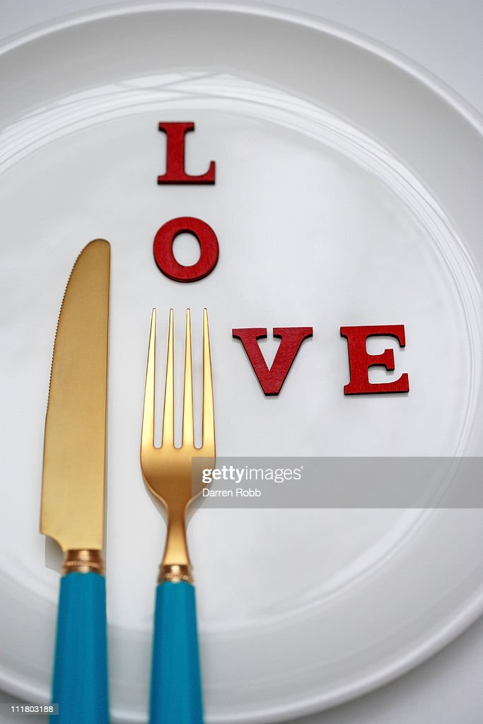 Dinner plate with knife and fork and the word LOVE : Stock Photo