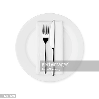 Dinner Setting dinner setting white plate knife fork and serviette stock photo
