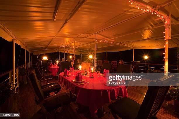 Dinner table setting aboard river cruise ship RV River Kwai, near Kanchanaburi.