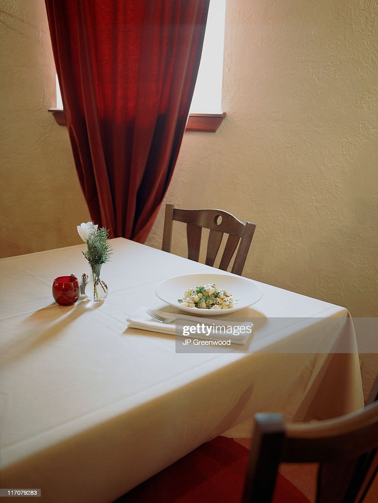 Dinner table with plate of food : Stock Photo