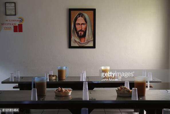 Dinner tables await immigrants many of them deportees from the United States at the Casa del Migrante September 23 2016 in Tijuana Mexico The shelter...
