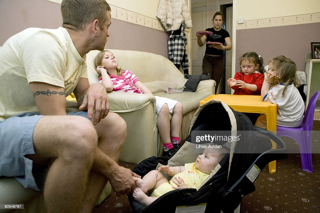 Dinner time for young family at home : Stock Photo