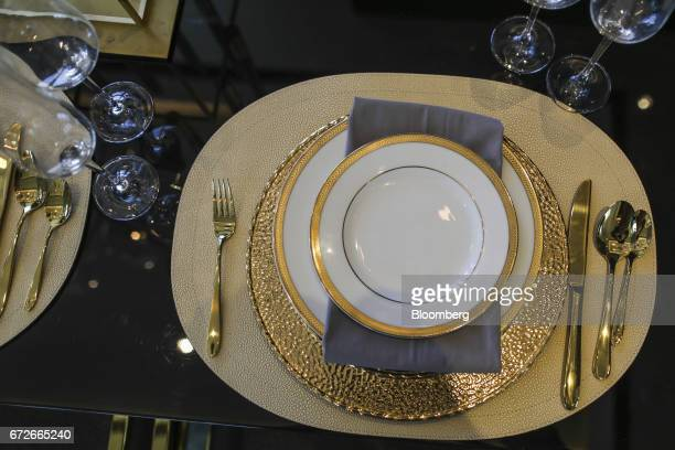 Dinnerware sits on a table inside a show home at Lodha Altamount a luxury residential project developed by Lodha Developers Ltd in Mumbai India on...