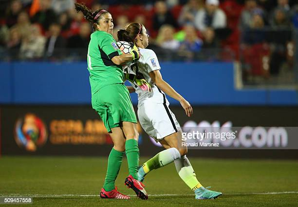 Dinnia Diaz of Costa Rica grabs the ball in front of Alex Morgan of USA during the 2016 CONCACAF Women's Olympic Qualifying at Toyota Stadium on...