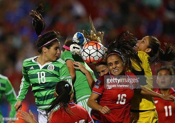 Dinnia Diaz of Costa Rica makes a save against Tanya Samarzich of Mexico during the CONCACAF Women's Olympic Qualifying 2016 at Toyota Stadium on...
