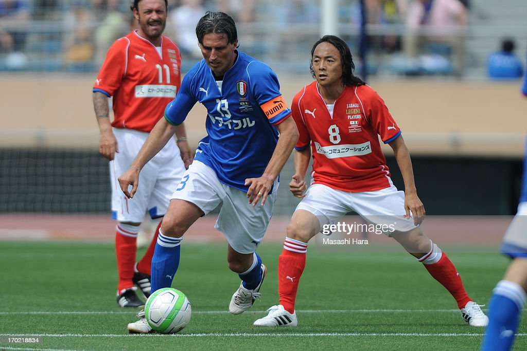 Dino Baggio #13 (L) in action during the J.League Legend and Glorie Azzurre match at the National Stadium on June 9, 2013 in Tokyo, Japan.