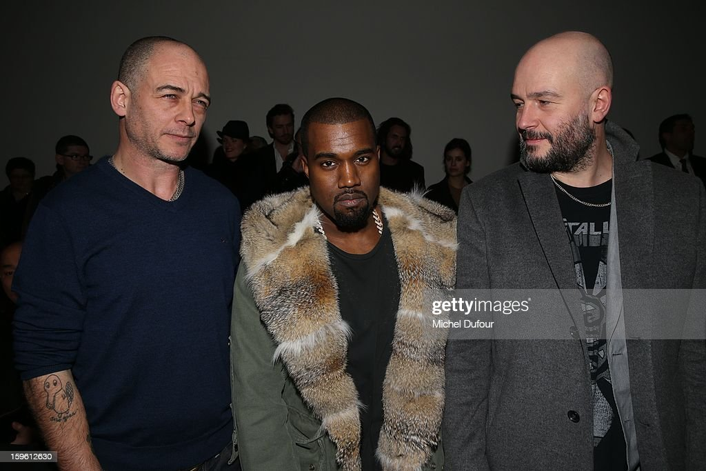 Dino Chapman, Kanye West and Jake Chapman attend the Louis Vuitton Men Autumn / Winter 2013 show as part of Paris Fashion Week on January 17, 2013 in Paris, France.
