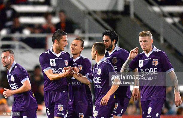 Dino Djulbic of the Glory celebrates with his team mates after scoring his second goal during the FFA Cup round of 32 match between the Brisbane Roar...
