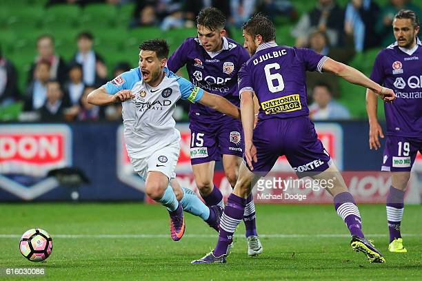 Dino Dulbic of the Glory gives away a penalty with this tackles on Bruno Fornaroli of the City during the round three ALeague match between Melbourne...