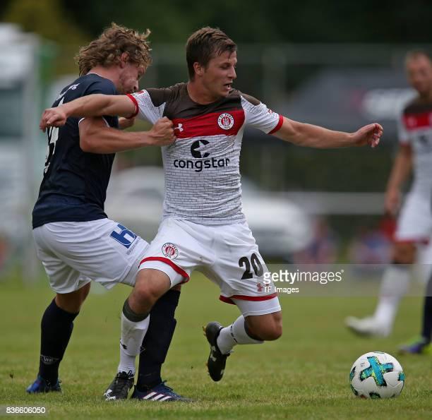 Dino Fazlic of Oldenburg and Richard Neudecker of St Pauli battle for the ball during the preseason friendly match between VfB Oldenburg and FC St...