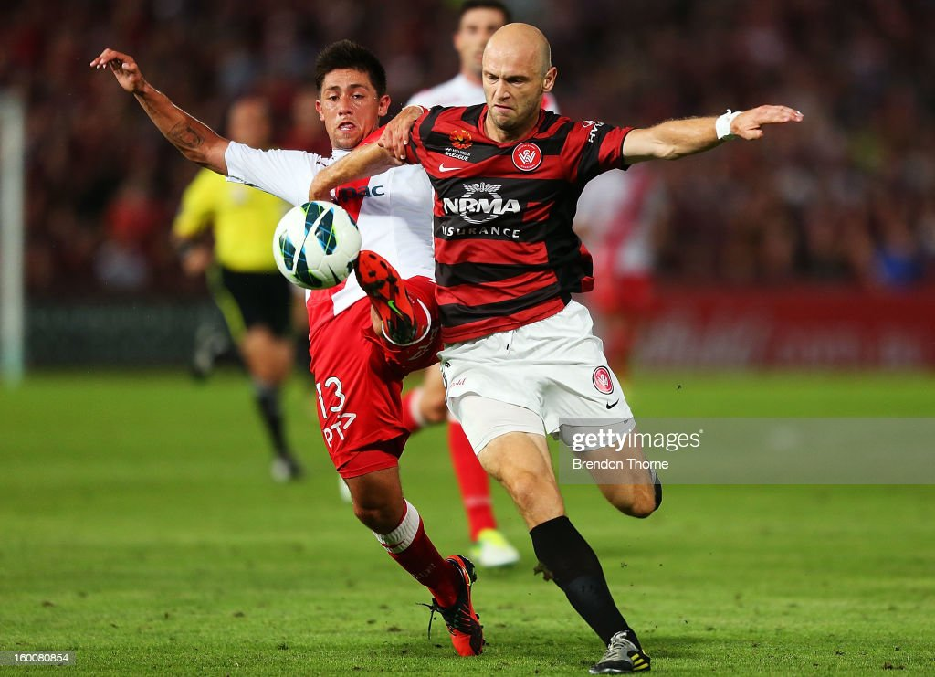 Dino Kresinger of the Wanderers competes with Jonathan Germano of the Heart during the round 18 A-League match between the Western Sydney Wanderers and the Melbourne Heart at Parramatta Stadium on January 26, 2013 in Sydney, Australia.