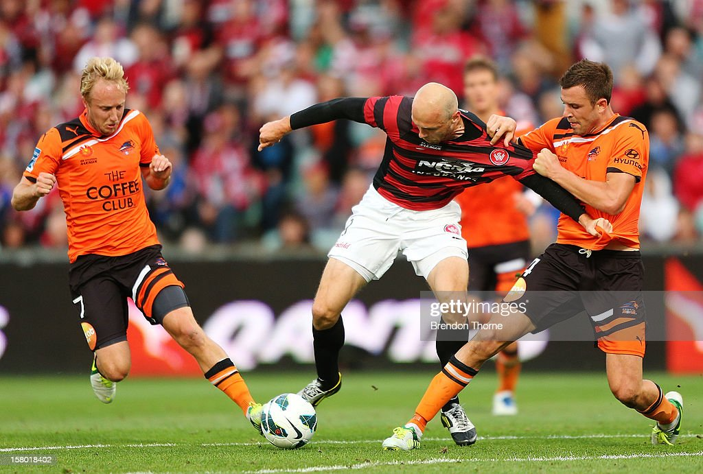 Dino Kresinger of the Wanderers competes with Matthew Jurman and Mitchell Nichols of the Roar during the round ten A-League match between the Western Sydney Wanderers and the Brisbane Roar at Parramatta Stadium on December 9, 2012 in Sydney, Australia.