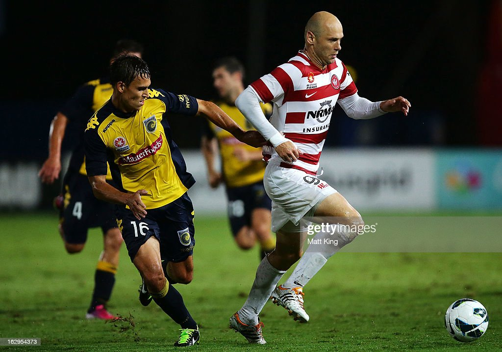 Dino Kresinger of the Wanderers is challenged by Trent Sainsbury of the Mariners during the round 23 A-League match between the Central Coast Mariners and the Western Sydney Wanderers at Bluetongue Stadium on March 2, 2013 in Gosford, Australia.