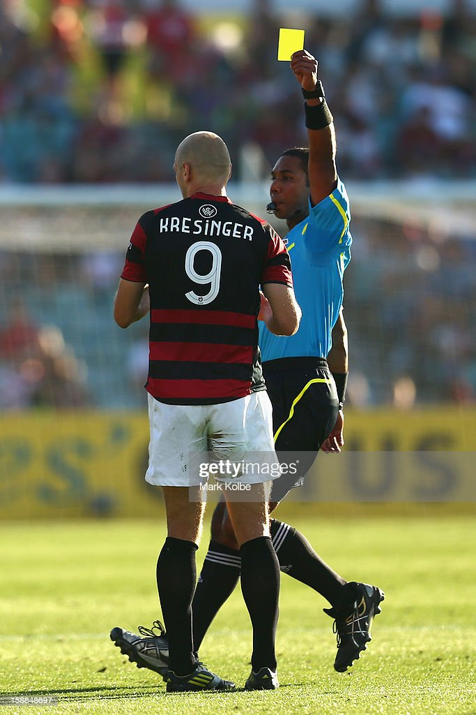 Dino Kresinger of the Wanderers is shown a yellow card by referee Lucien Laverdure during the round 14 A-League match between the Western Sydney Wanderers and the Melbourne Victory at Parramatta Stadium on January 1, 2013 in Sydney, Australia.