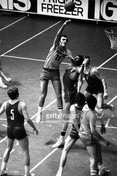 Dino Meneghin the Italian basketball pivot in the act of shooting a basket during a match the young sportsman is wearing the shirt of Ignis Varese...