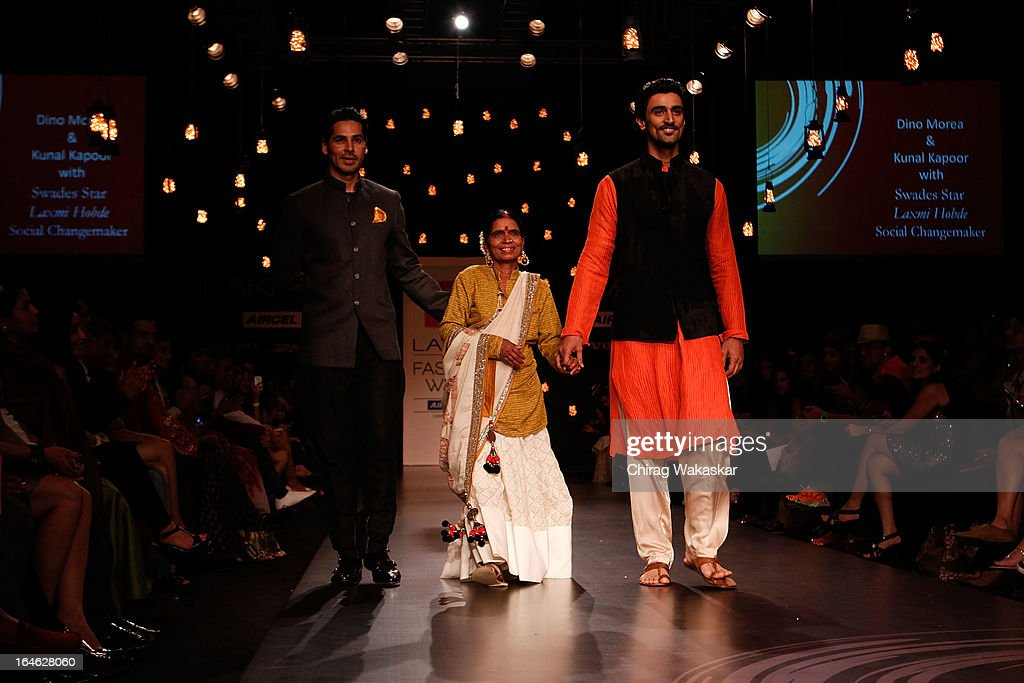 Dino Morea, Laxmi Hobde & Kunal Kapoor showcase designs by Vikram Phadnis on the runway during day four of Lakme Fashion Week Summer/Resort 2013 on March 25, 2013 at Grand Hyatt in Mumbai, India.